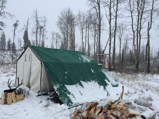 tarped wall tent in snow